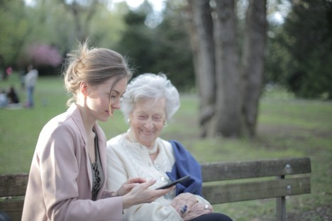 Daughter-explaining-elderly-mother-how-using-smartphone-3791666
